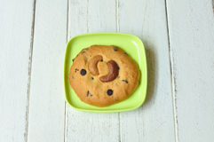 Almond-cookie on green plate on wood table Stock Photography