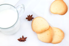 Almond cookies. Freshly baked almond cookies with a milk on a white background Stock Image