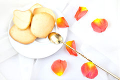 Almond cookies. Freshly baked almond cookies with a rose petals Royalty Free Stock Photos