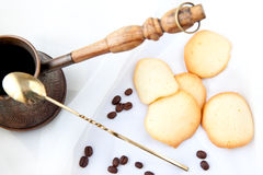 Almond cookies and coffee. Homemade almond cookies with a coffee on a white background Royalty Free Stock Image