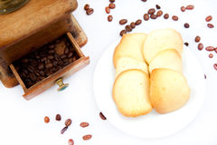 Almond cookies and coffee. Homemade cookies with a coffee beans on a white background Stock Images