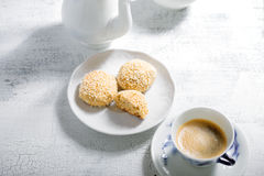 Almond cookies and coffee on white table.  Stock Image