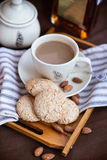 Almond cookies and cup of coffee Stock Photo