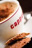 Almond cookies and cuppuccino Royalty Free Stock Images