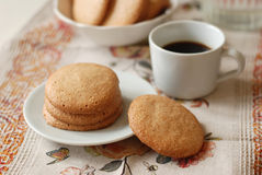 Almond cookies. Homemade almond cookies with a cup of coffee on a linen napkin Stock Photo