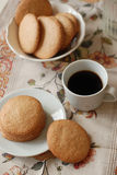 Almond cookies. Homemade almond cookies with a cup of coffee on a linen napkin Royalty Free Stock Images