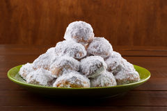 Almond cookies with icing. Traditional cookies with almonds on dark wooden table stock photography
