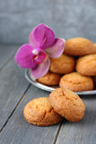 Almond cookies with orchid flower   Stock Photography