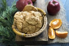 Almond cookies on a wooden with tangerines Royalty Free Stock Photography
