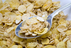 Almond Cornflake Cereal. Shot of a cornflake cereal with almonds in a bowl without milk and with a spoon stock image