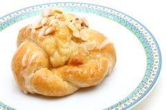 Almond croissant on dish Stock Photos