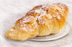 Almond croissant. On a glass plate Royalty Free Stock Photography