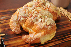 Almond croissants with custard filling Stock Photos