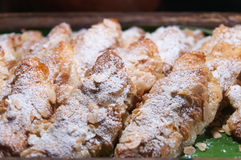 Almond croissants on wood plate. Stock Image