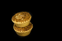 Almond cup cake on black background Stock Photography