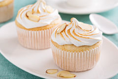 Almond cupcakes with meringue tops Stock Photo