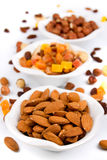 Almond with dried fruit and nuts. Isolated on white background Royalty Free Stock Photography