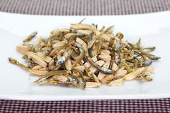 Almond and dried small fish Stock Image