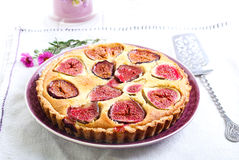 Almond and fig tart on plate Stock Photography