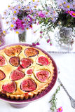Almond and fig tart on plate Stock Photos