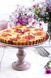 Almond and fig tart on plate stock photo
