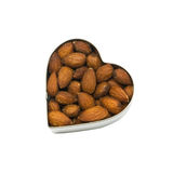 Almond filled heart. Top down view of heart filled with almonds isolated on a white background royalty free stock photo