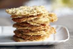 Almond flaked cookies. Stalked on a white plate Royalty Free Stock Photos