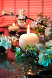 Almond flowers with candle - light for color therapy treatment. For massage stock photos