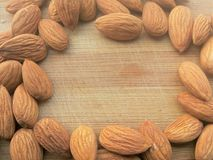 Almond frame on wooden background Stock Photo
