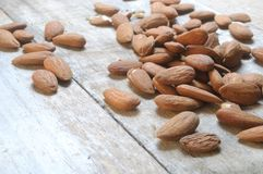 Almond fruit dry on wood table surface Royalty Free Stock Photos