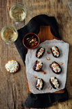 Almond and goat cheese stuffed dates Stock Photos