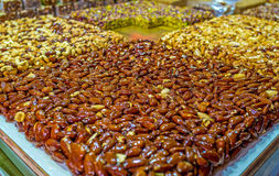 The almond gozinaki. The tasty almond gozinaki - nuts in sweet caramel of honey and sugar, Turkish Bazaar in Acre, Israel Royalty Free Stock Images