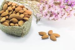 Almond grains on white clean table Stock Photos