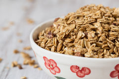 Almond Granola Breakfast Cereal In Bowl. Almond breakfast granola in floral bowl stock images