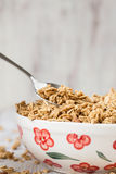 Almond Granola Breakfast Cereal In Bowl With Spoon Stock Images