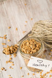 Almond Granola With Heart Healthy Tag On Jar And Spoon Stock Photography