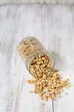 Almond Granola Spilling From Glass Jar Stock Images