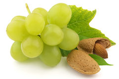 Almond with grapes Stock Images