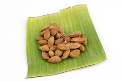 Almond on green banana leaves Stock Image
