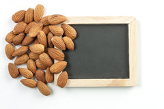 Almond, group of almonds and blackboard on over white background. Almond, group of almonds and  blackboard on over white background. with  blackboard for your Royalty Free Stock Photos
