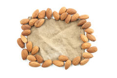 Almond, group of almonds and vintage fabric cotton on over white. Background. with vintage fabric for your text. top view Royalty Free Stock Image