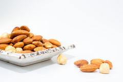 Almond and Hazel nuts Stock Images