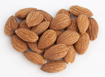 Almond heart Stock Images