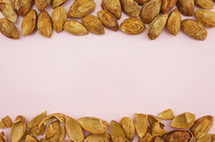 Almond with hull background Stock Photography
