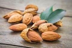 Almond with leaves on wooden table Royalty Free Stock Image
