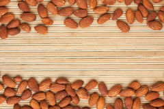 Almond lies on the a bamboo mat Royalty Free Stock Image