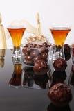 Almond liquor. And almond snacks Stock Image