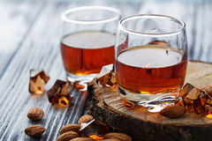 Almond liquor amaretto and almonds Stock Photos
