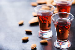 Almond liquor amaretto on a grunge black table Stock Image
