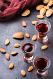 Almond liquor amaretto on a grunge black table Royalty Free Stock Photo